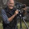 Portrait of photographer Charlie Waite with camera